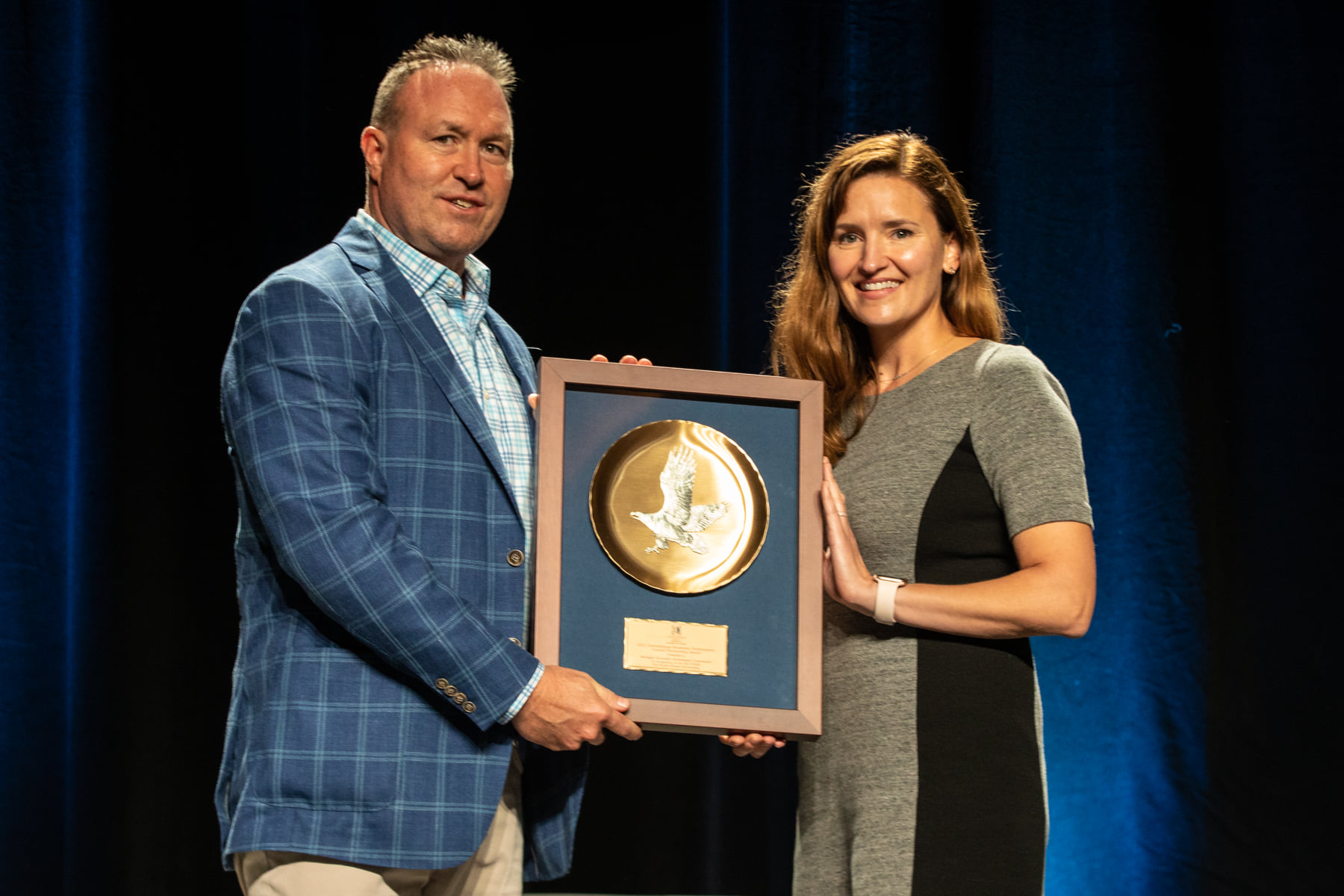 Picture of Pat Gillespie Receiving the IEDC Gold Rank Award for Block600