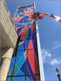 Let me in mural by artist Bruce Mackley